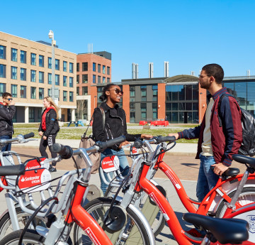 Students using Santander bikes on Bay Campus